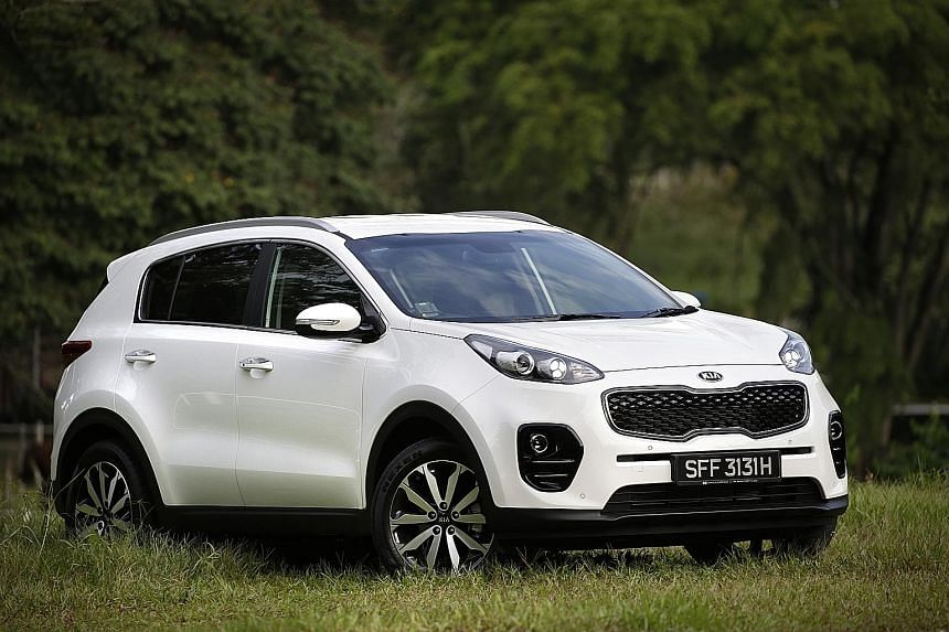 The new Kia Sportage has a leather-wrapped multi-function steering wheel.