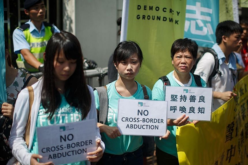 Protesters from pro-democracy group Demosisto outside China's liaison office in Hong Kong yesterday.