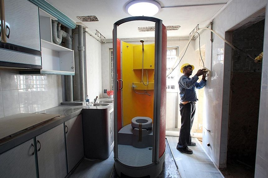 For those having their homes renovated under the Home Improvement Programme, a portable toilet that comes with a heated shower is installed inside the flat at night but dismantled during the day. For those who are renovating on their own, ask your co