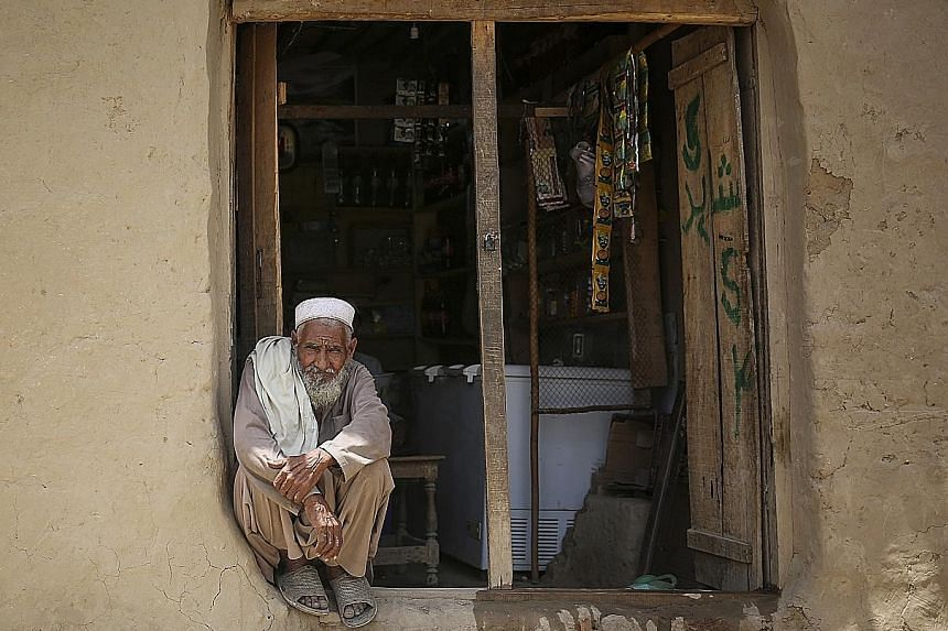An Afghan refugee outside a grocery store in Utmanzai refugee camp. He is but one of at least 1.5 million documented refugees caught in the middle of a wider spat involving Afghanistan, Pakistan and the US. Pakistan wants all the refugees gone by the