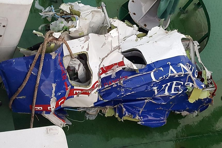 Debris found in the Gulf of Tonkin after Vietnam's coastguard plane crashed in a rescue mission.