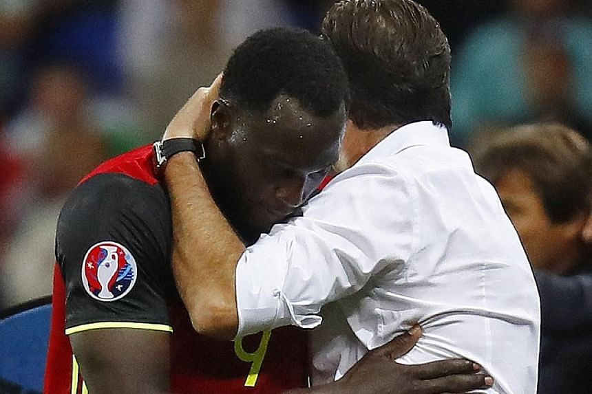 Romelu Lukaku embracing Marc Wilmots after being taken off against Italy. The Everton striker's abject display in their opening group game may prompt his coach to vary his forward selection against the Irish.