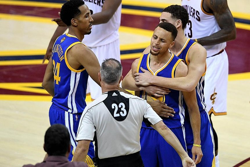 Golden State's Stephen Curry is floored after colliding with LeBron James while going for a loose ball in the first half. Two early fouls against Curry, who was later ejected, helped set the tone for Cleveland's 115-101 home victory in Game 6 on Thur