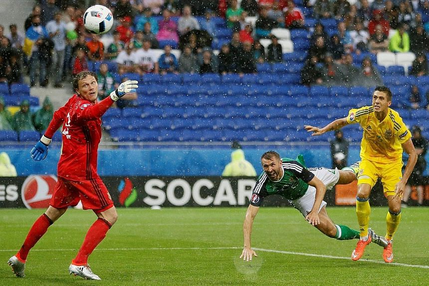 """Gareth McAuley (middle) of Northern Ireland scoring the opening goal in the 2-0 win against Ukraine on Thursday. """"We've got a big game to look forward to in Paris,"""" he said of the looming clash against Germany."""