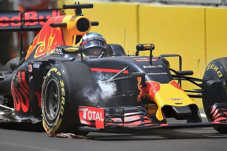 Red Bull driver Daniel Ricciardo sits in his damaged car after swiping a wall during a practice session for the European GP. The metal kerbs used at the Baku circuit have been criticised, with experts weighing in on safety concerns.