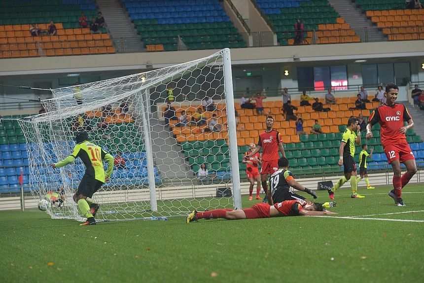 Balestier's players (in red) are left deflated after Tampines' Billy Mehmet opened the scoring in the sixth minute of the game.