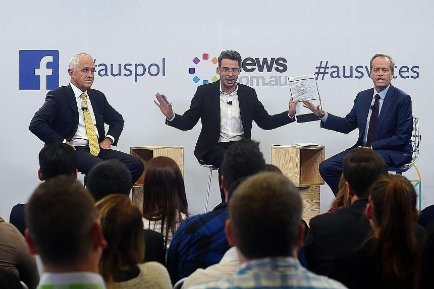 Mr Turnbull (left) and Mr Shorten (right) with moderator Joe Hildebrand during last night's debate, which was live-streamed via Facebook Live and broadcast on television. The Australian election will be held on July 2.