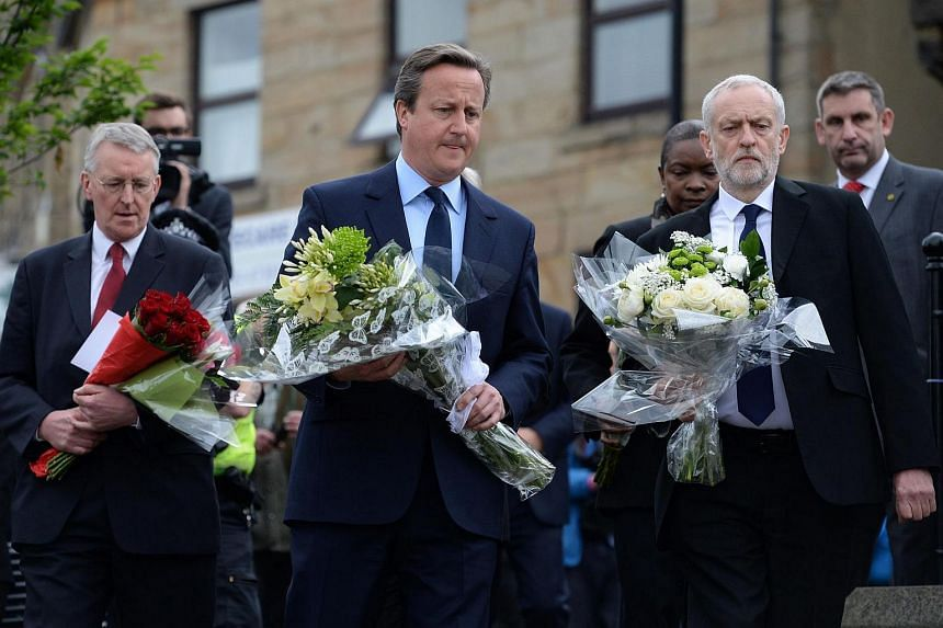 British Prime Minister David Cameron (centre) and Labour leader Jeremy Corbyn (second from right) preparing to lay flowers in memory of slain Labour MP Jo Cox, in Birstall, on June 17.