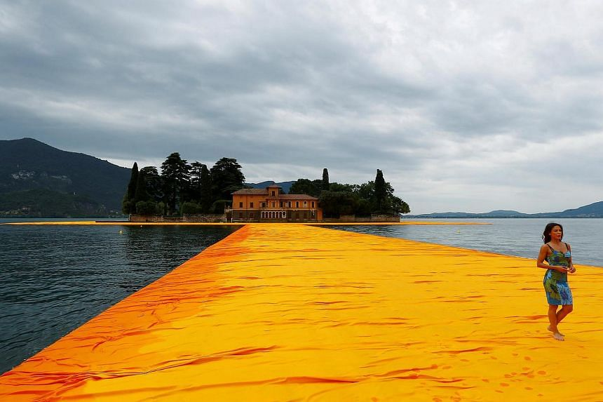 The Floating Piers cost 15 million euros to create but will be free to the public and is expected to attract 500,000 visitors by the time it closes.