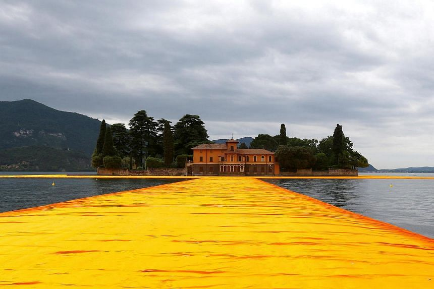 Made of 200,000 recyclable polyethylene cubes linked by 200,000 giant screws, the piers are covered with dahlia-yellow fabric made of tightly woven nylon designed to change tone as the sun sets and become an intense red when wet.