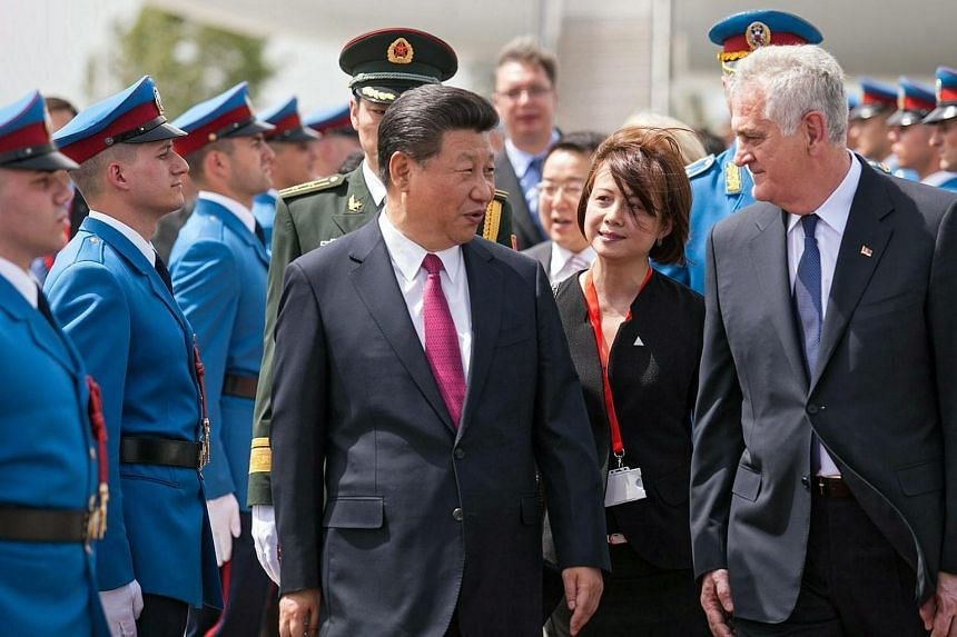 Chinese President Xi Jinping (centre, left) and Serbian President Tomislav Nikolic reviewing an honour guard during a welcome ceremony at Nikola Tesla airport in Belgrade on June 17.