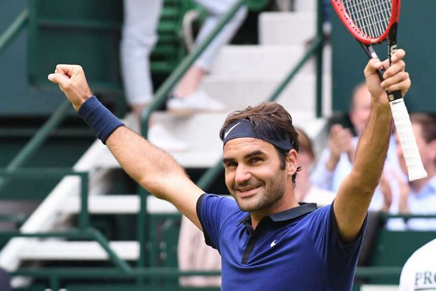 Federer celebrates his quarter-final win over David Goffin.