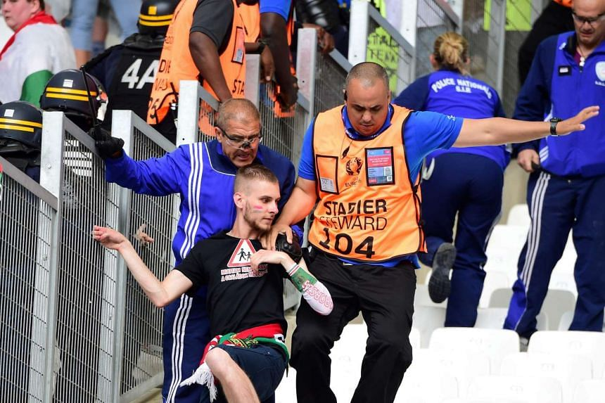 A man is arrested following clashes between groups of supporters ahead of the match.