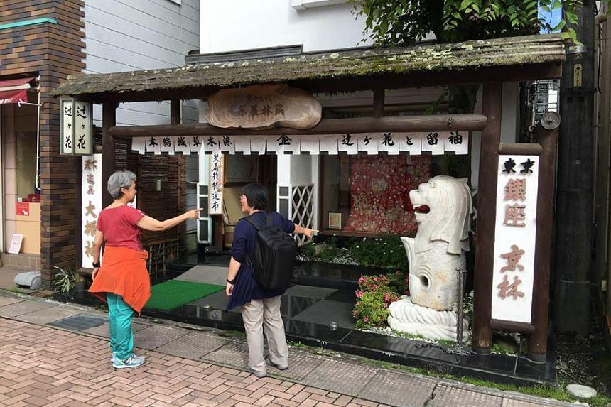 A statue of the Merlion at a kimono shop in Karuizawa, Japan.
