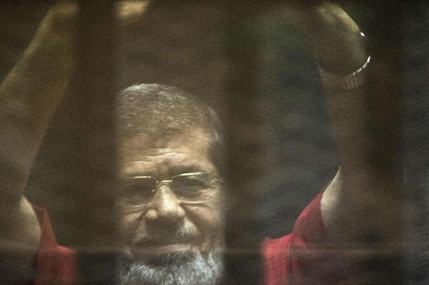 Ousted president Mohamed Mursi during his trial at the police academy in Cairo on May 7, 2016.