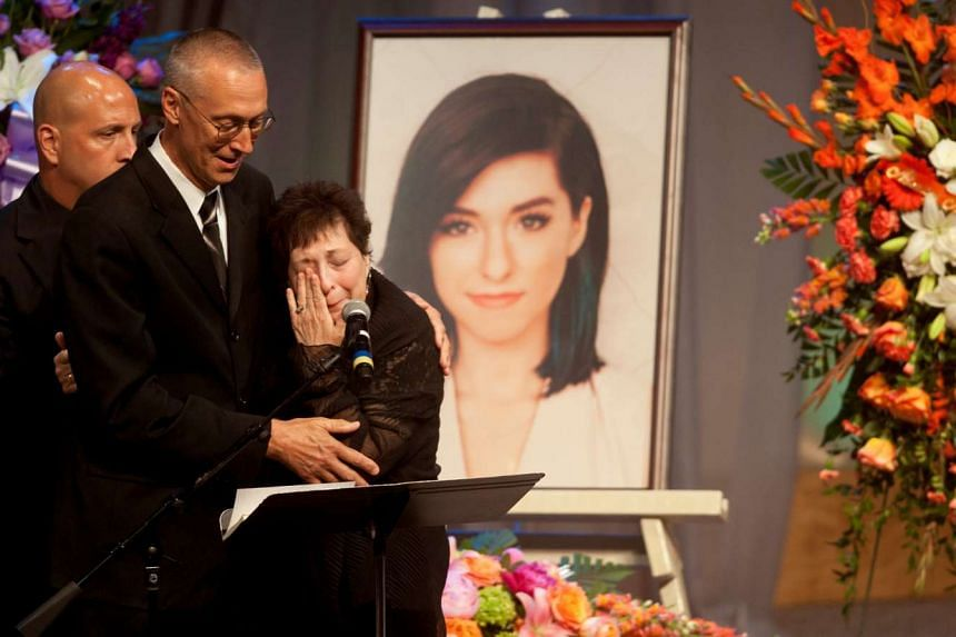 Christina Grimmie's mother Tina is comforted by her husband Bud during the memorial service in Medford, New Jersey.