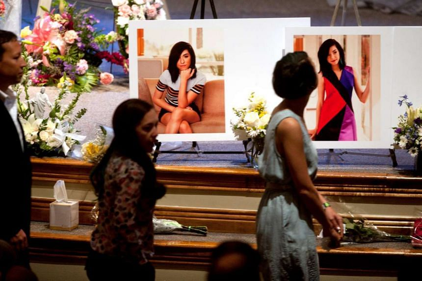 Photographs of Christina Grimmie are displayed during the memorial service.