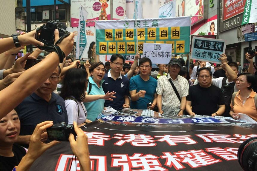 The march was organised to show support for Mr Lam Wing Kee, a bookseller who disappeared last year.