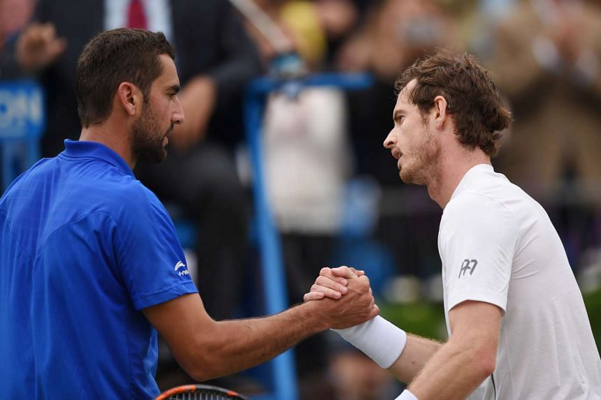 Andy Murray (right) shakes the hand of Croatia's Marin Cilic after winning his semi final match.