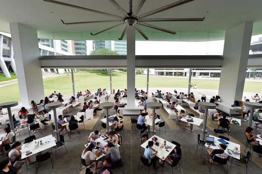 Students at a self-study area in NUS.