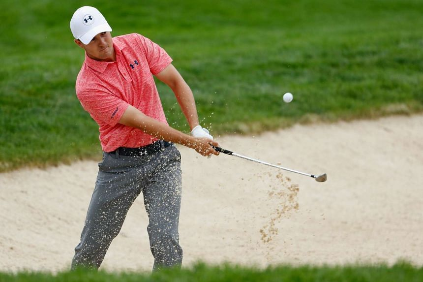 Spieth plays a bunker shot during the continuation of the weather delayed first round of the US Open.
