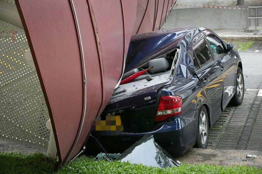 The 20m-long shelter in Bukit Batok West Avenue 6 fell on a car after being hit by a lorry early yesterday.