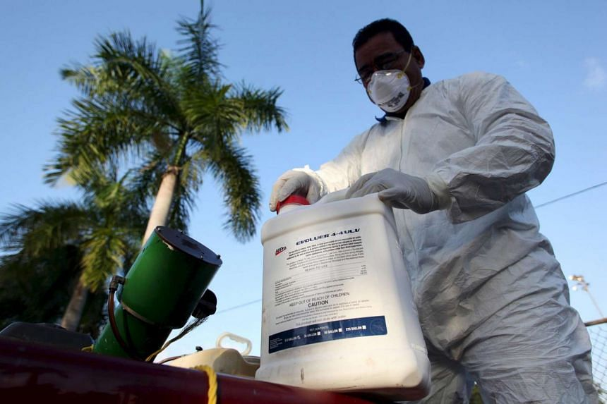 A health worker preparing insecticide before fumigating a neighbourhood in San Juan, Puerto Rico, on Jan 27.