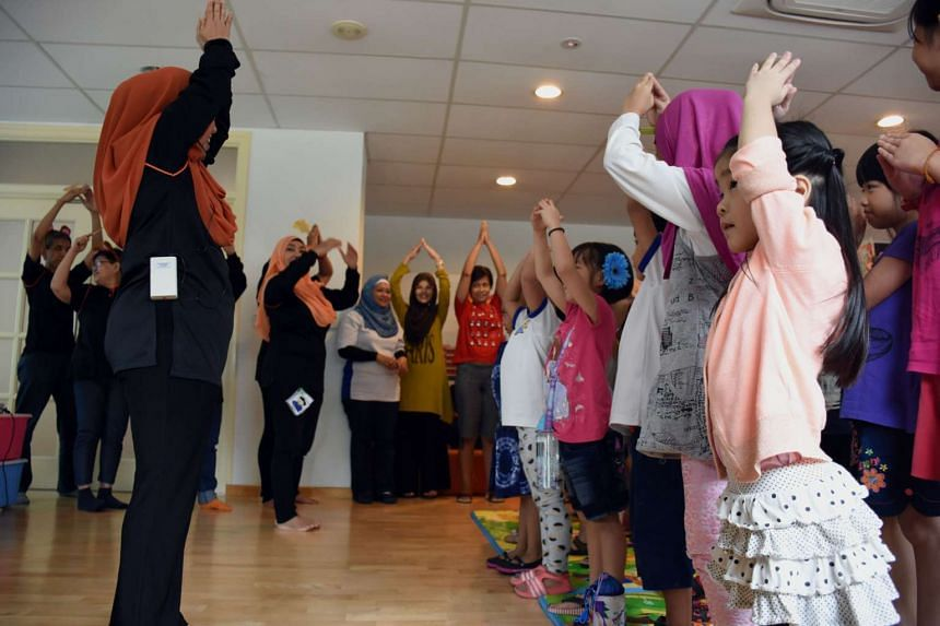 Children dancing at library, which provides a new play area for children with special needs.