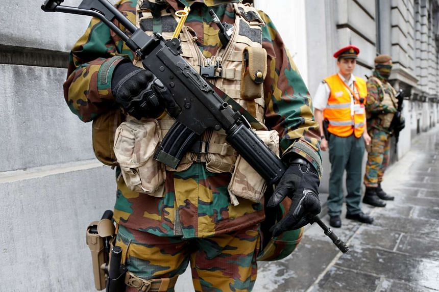 A Belgian soldier stands guard during a meeting of the government's security council in Brussels on June 18, 2016.