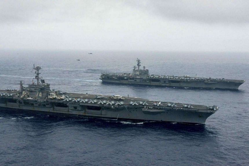 The USS John C. Stennis and USS Ronald Reagan, among the world's largest warships, began conducting air defence drills, sea surveillance, and long range strikes on Saturday (June 18).