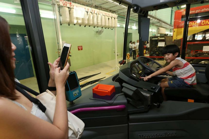 Five-year-old Lacus Lim at the wheel of a bus as his mother Choe Foo takes his photo, at the Official opening ceremony of Go-Ahead Singapore's Loyang Bus Depot on June 19, 2016.