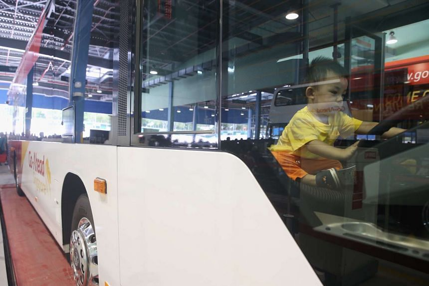 One-year-old Irvin Ong at the wheel of a bus at the Official opening ceremony of Go-Ahead Singapore's Loyang Bus Depot on June 19, 2016.