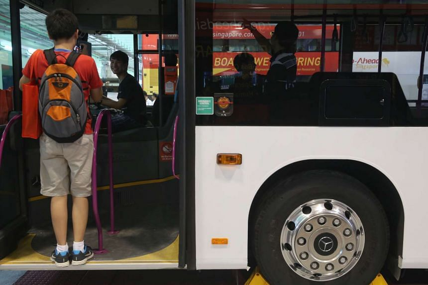 Bus enthusiasts on a single-deck bus at the Official opening ceremony of Go-Ahead Singapore's Loyang Bus Depot on June 19, 2016.