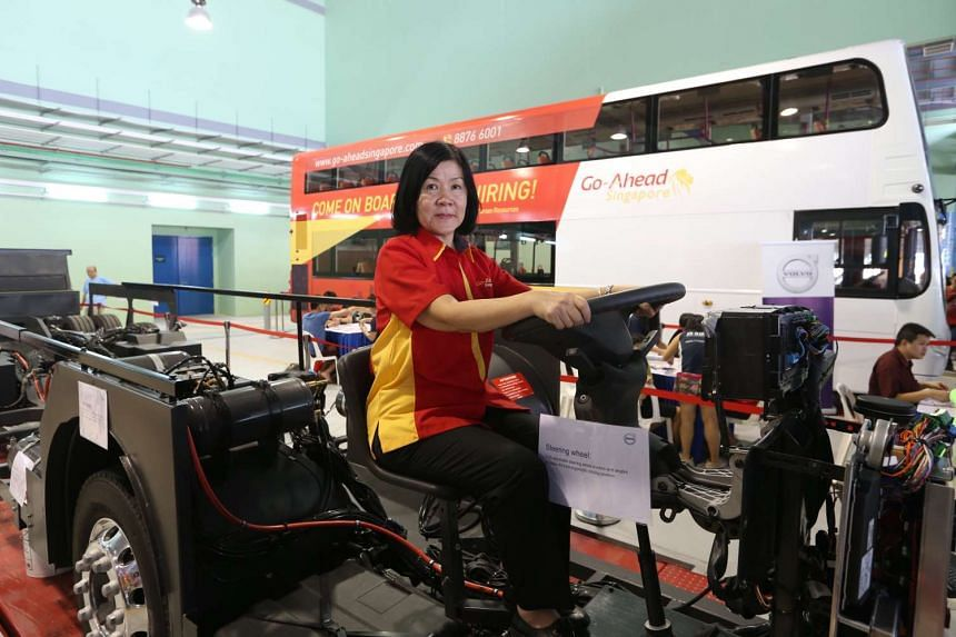 Go-Ahead bus captain Janice Tan pose for a photo on a skeleton of a Volvo double-deck bus at the Official opening ceremony of Go-Ahead Singapore's Loyang Bus Depot on June 19, 2016.
