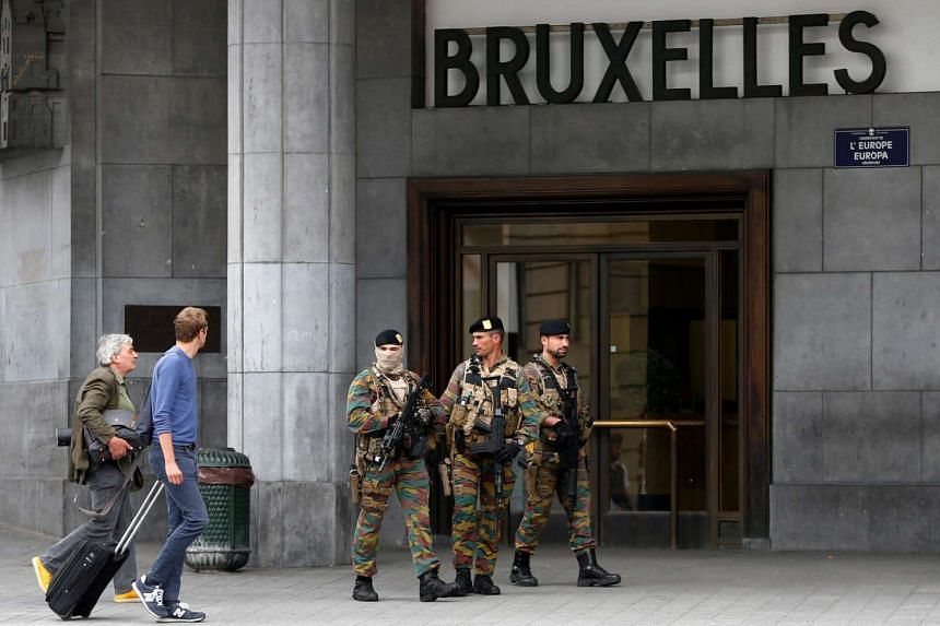 Belgian soldiers patrol outside the central train station where a suspect package was found, in Brussels, Belgium on June 19, 2016.