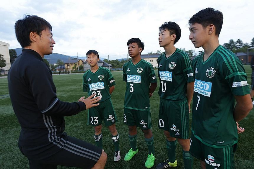 A Matsumoto Yamaga coach debriefing the Singapore U-15 boys (from left) Elijah Lim, Muhammad Nur Adam Abdullah, Ashley Yong and Christian Chiang after a practice game. The FAS hopes the boys, who have ended their week-long stint in Matsumoto, can bri
