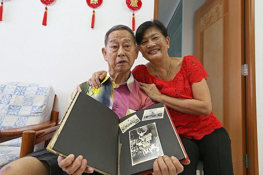 Mr Chia (left), with his wife Madam Ong, shows off his prized photo album containing pictures of his time with the Kong Chow Clan Acrobatic Cycling Troupe (far left). The pictures will be uploaded onto NHB's roots.sg portal - a website on Singapore's