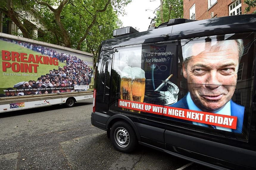 """Ukip leader Nigel Farage, whose campaigning has been characterised by anti-immigration rhetoric, unveiled a new poster showing a long line of refugees with the headline """"Breaking Point"""", prompting pro-EU activists to launch vans sporting posters ridi"""