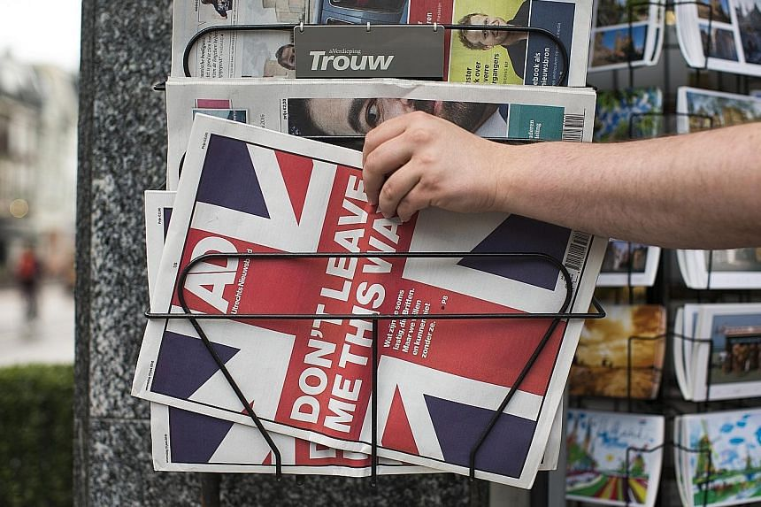 Britons have been bombarded with pro- and anti-EU messages everywhere - even at the Royal Ascot Racecourse (above), and beyond Britain too. A Dutch newspaper's front-page headline (top) last Wednesday said Don't Leave Me This Way.