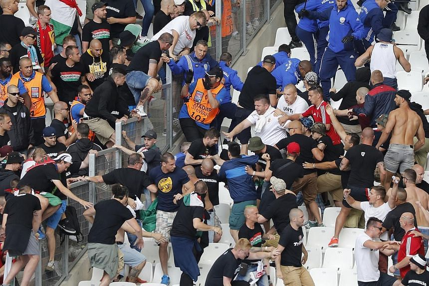 Hungarian fans clashing with stewards ahead of their country's match against Iceland yesterday in Marseille. Witnesses said the stewards had refused to let two fan groups separated by a security barrier into the same section.