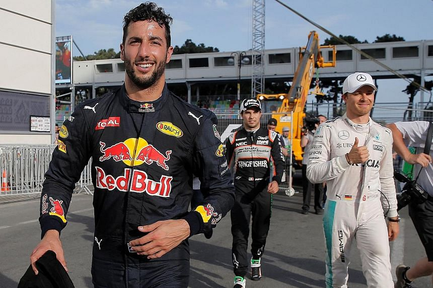 In good cheer in the paddock area after qualifying are (from left) Red Bull's Daniel Ricciardo, Force India's Sergio Perez and Mercedes' Nico Rosberg. Perez will start seventh after a gear-box change penalty, so Ricciardo will begin alongside pole-si