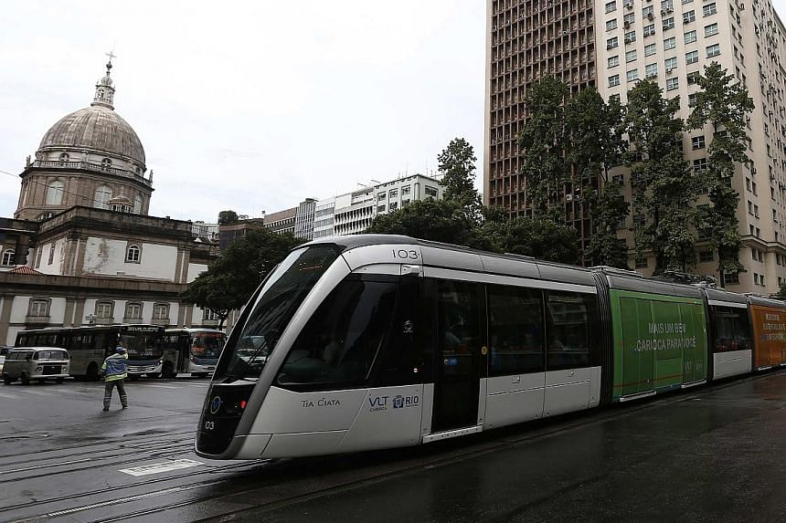 "An electric tramway replaces numerous bus lines in the Rio de Janeiro city centre, in the run-up to the Olympics. The state says it is in need of emergency measures to avoid ""a total collapse in public security, health, education, transport and envir"