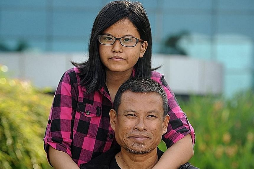 "Mr Shariff with his 16-year-old daughter Athirah, who has liver cirrhosis. The 47-year-old, who runs marathons despite having his left limb amputated in 2008 because of a skin infection, calls Athirah his ""biggest motivation""."