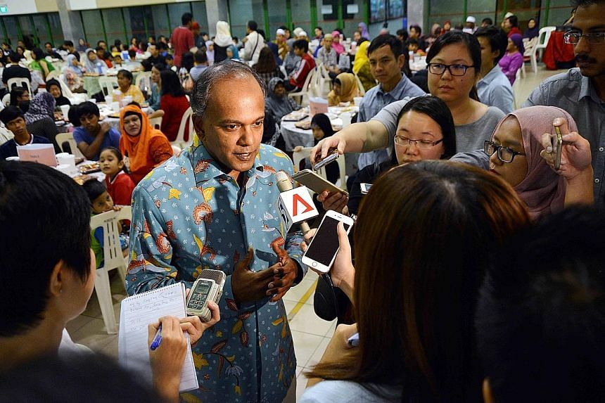 Mr Shanmugam speaking to reporters before the iftar at the Chong Pang Community Club yesterday, where more than 400 residents broke fast together.