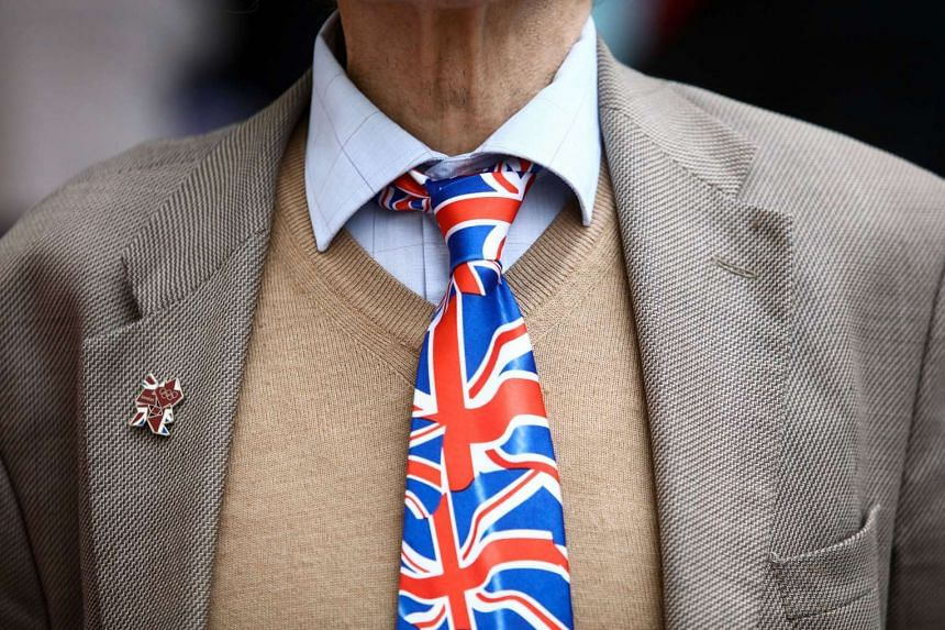 A pedestrian wears a tie featuring the British Union flag, commonly known as a Union Jack, in London on June 10, 2016.