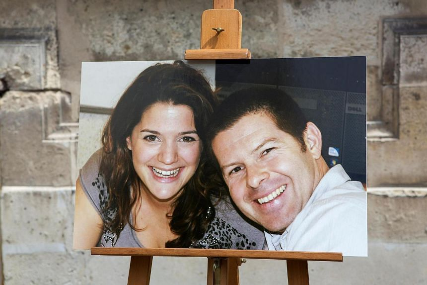 The portraits of French police commander Jean-Baptiste Salvaing (right) and his companion, administrative agent Jessica Schneider are seen at a ceremony in the courtyard at the Interior Ministry in Paris, France.