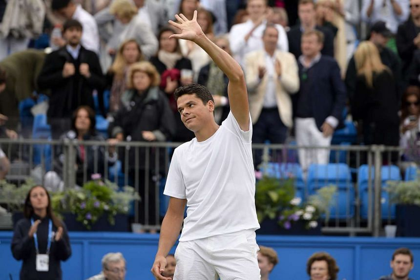 Raonic reacts after beating Australia's Bernard Tomic in the semis.
