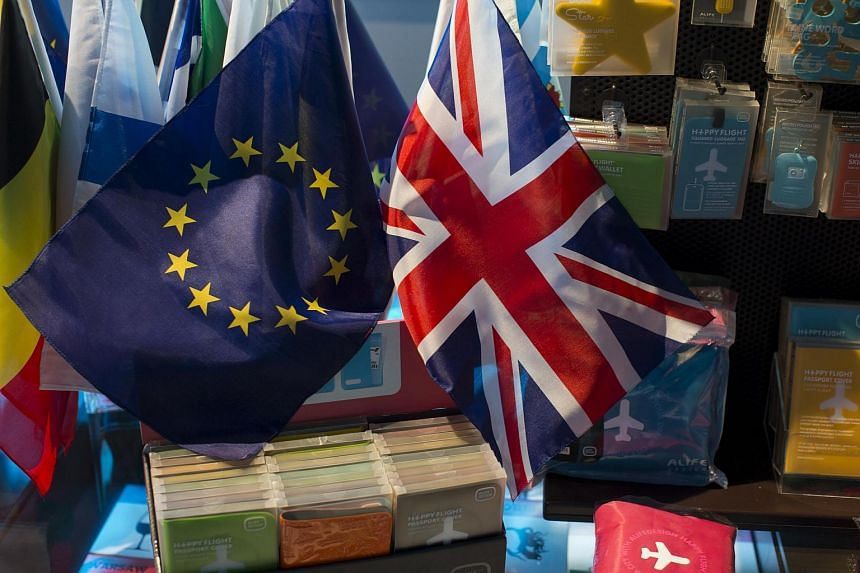The British Union Flag (right)and the European Union (EU) flag is seen on display at a gift shop at the Parlamentarium in Brussels, Belgium.