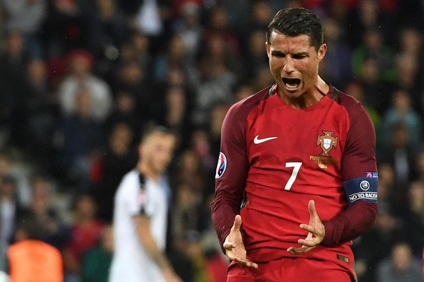 Ronaldo reacts after missing the penalty.