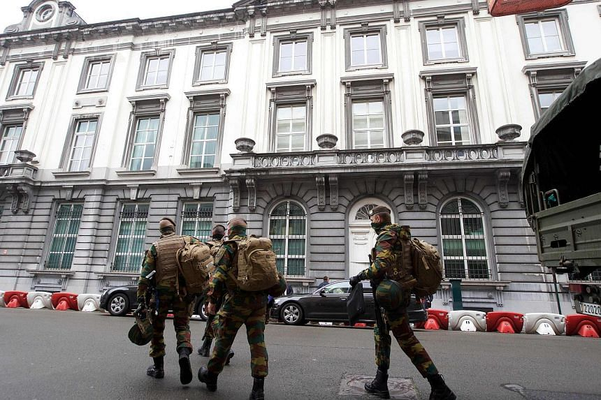 Belgian soldiers walk the streets after the dismantling of a new terrorist unit  in Brussels, on June 18.